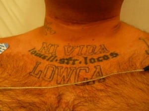 """Figure 2. Mi vida Loca = My crazy life also seen as  in many patients; in this case, """"LOWCA"""" is a reference to low riders and the automotive culture associated with them. The gang is """"Lowell Street,"""" indicating a traditional Hispanic """"turf gang"""" that is """"loco""""—crazy or brave."""